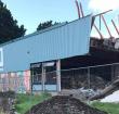 Sloop Ashram College vordert gestaag, aula bijna helemaal tegen de vlakte